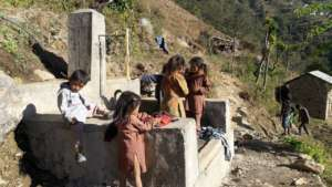 Children at the water supply
