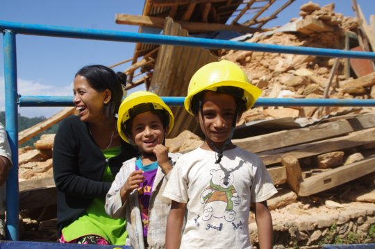 Girls at a shelter construction site