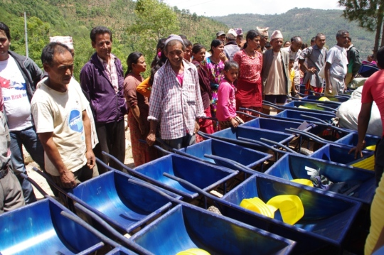 Sindhupalchowk villagers inspect new repair tools