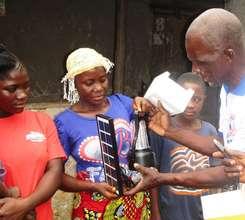 Village mother receiving her 560 lumens lantern