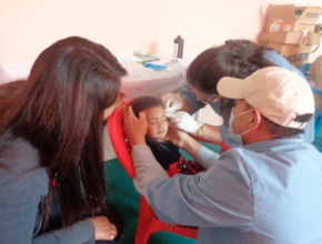 Young child gets wound treatment at Health Camp