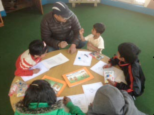 Child Workers in Nepal (CWIN) read healing book