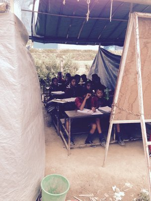 Children attend school in makeshift classrooms