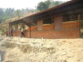 Some skilled laborers are busy rebuilding homes.