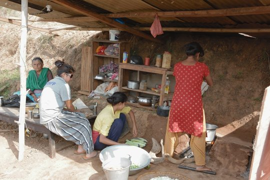 3 generations in makeshift kitchen in the village