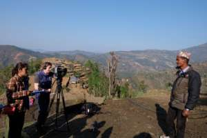 NT manager Anu Lama and Anna filming village elder