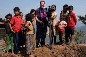 Anna with local children.