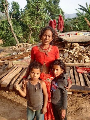 Mother, children and wrecked home.