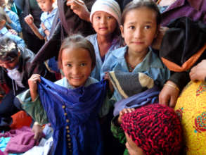 Children with their new hats and blankets