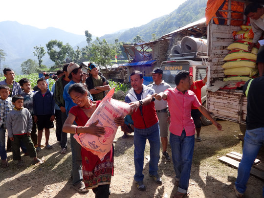 Delivering relif supplies to remote village