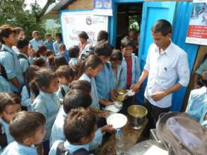 NYF staff served hot lunches to hungry children