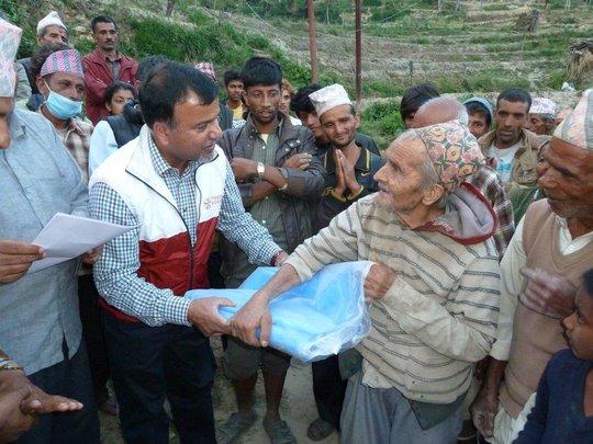 NYF president Som Paneru delivers tarps in Kavre