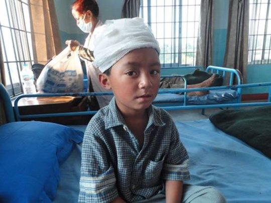 Young boy with head injury in NYF recovery clinic