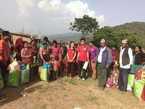 TFN Fellows with community members at distribution