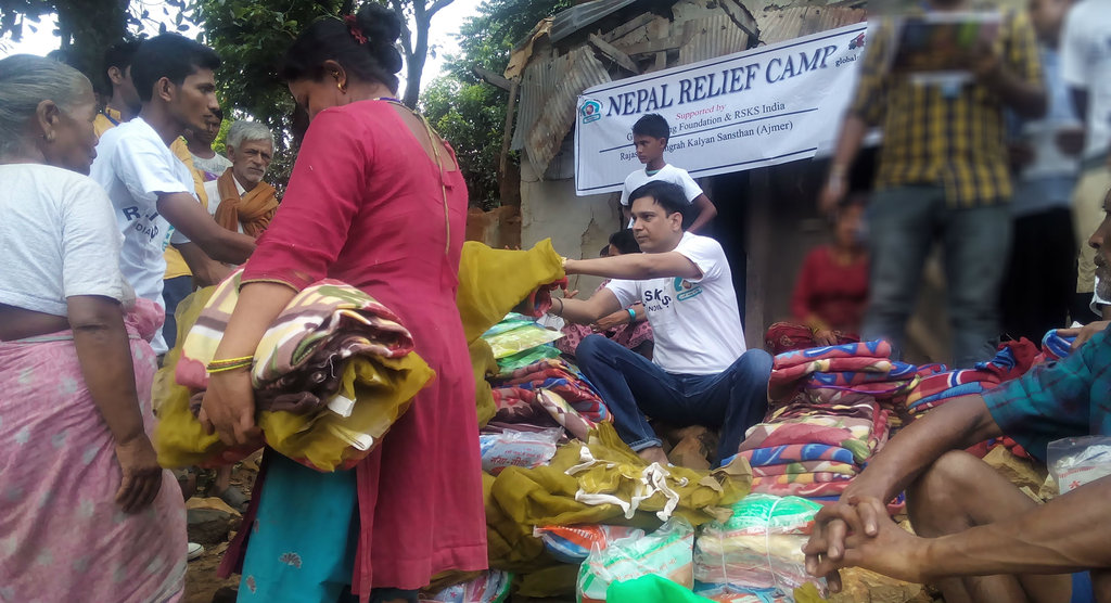 Relief Material Distribution to victims at a camp