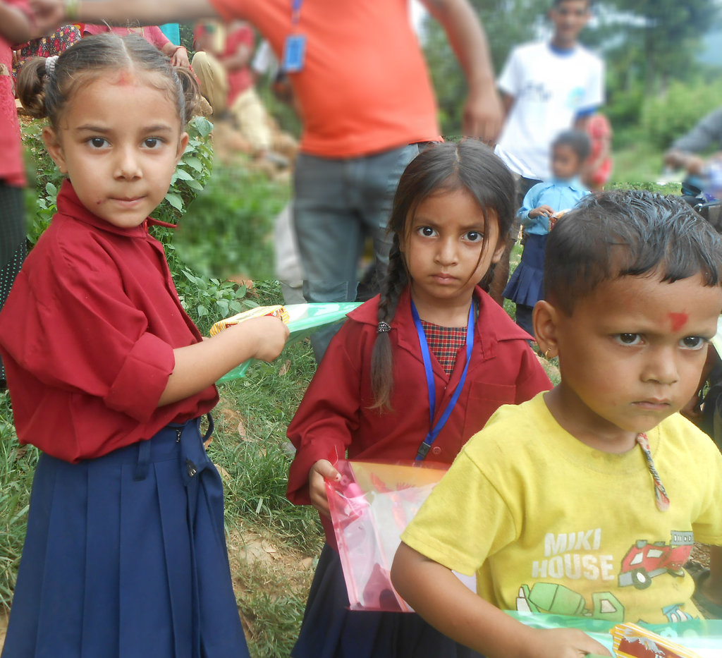 school children with stationery kits