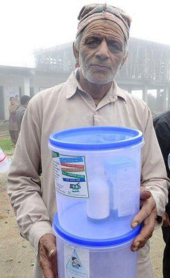 A villager with the water filter