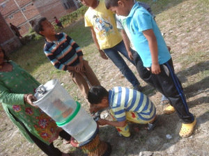Children using the ECCA water filter