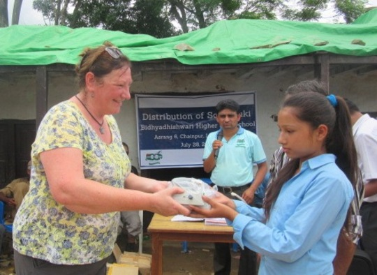 Globalgiving UK representative distributing