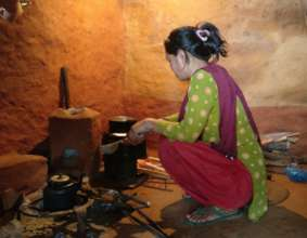 Improved cookstove being used (towards right)
