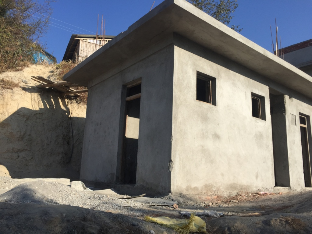 Ongoing toilet construction with separate sections