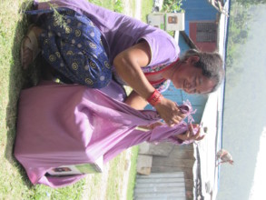 Villager getting ready to carry home the cookstove