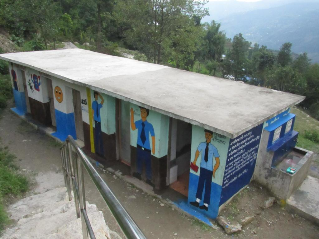 Repaired toilet along with hand washing station