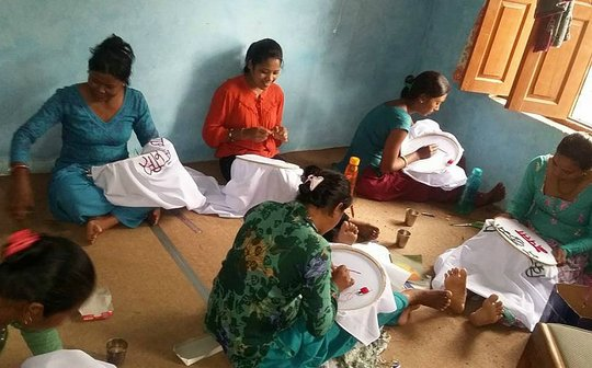 Wives of the disappeared at work on embroidery