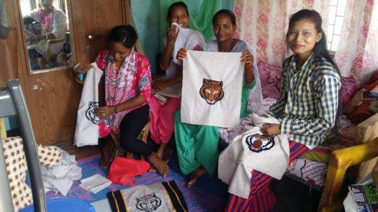 Alina and friends sell Tiger bags in Bardiya