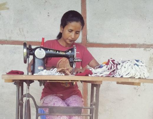Sarita making masks