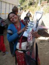 Nepalese woman receiving her support-kit