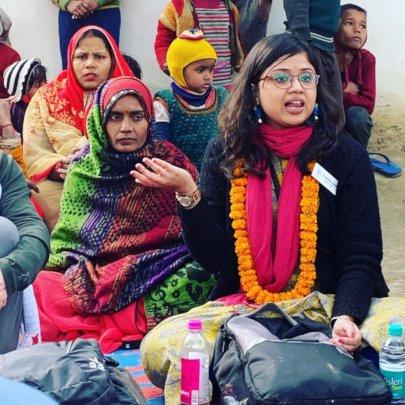 Shadhika's Program Officer addressing Women