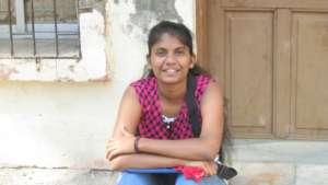 Durga outside of her community VACHA center