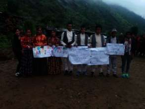 Villagers with the posters against Human Trafficking.jpg