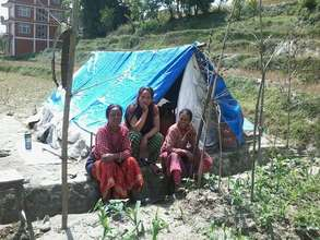 SASANE paralegal with her family in tent