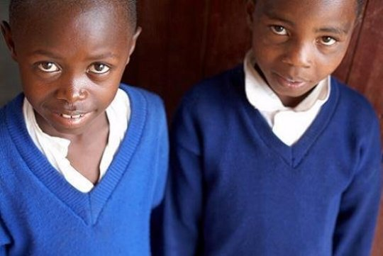 Two primary school students supported by Camfed