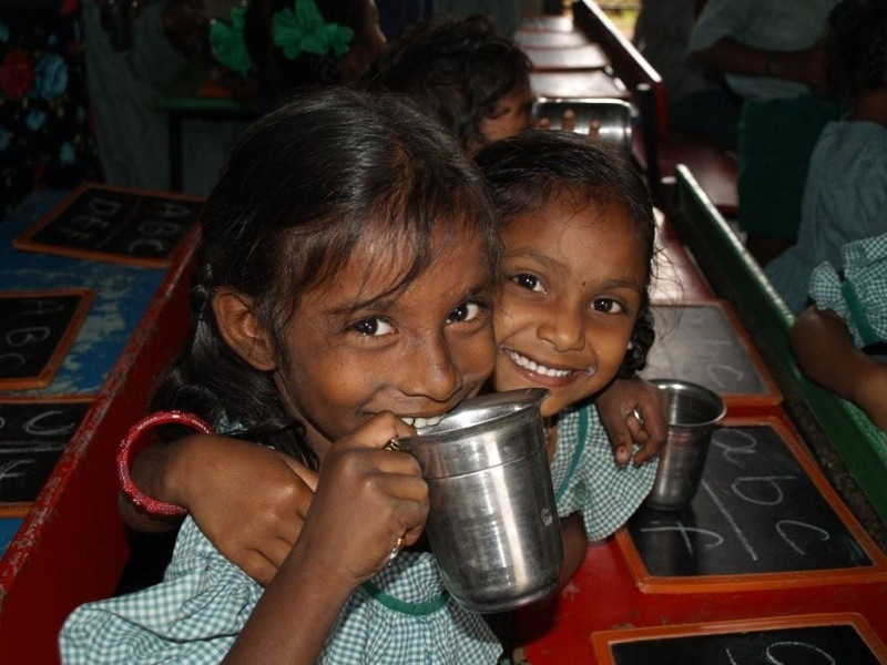 Milk distribution at our literacy center in Kandrika
