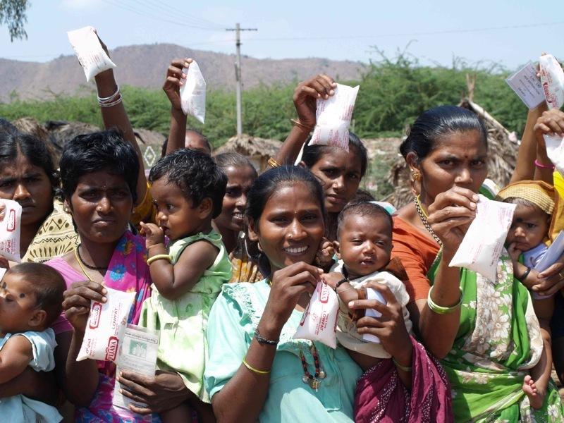 Milk distribution to babies in Rajarajeswari.
