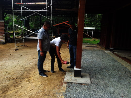 Pouring libation to bless building stage