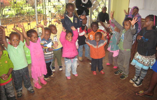 Heshima children sing a song together