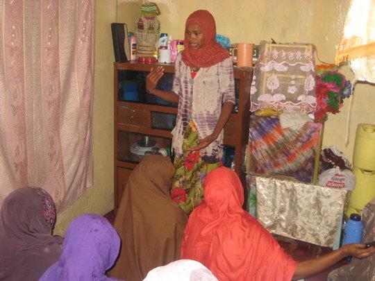 Halima teaching her peers