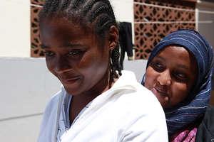Miriam with Hamdi, a Heshima Caseworker.