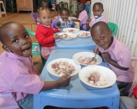 KiMMTa Children enjoying a meal