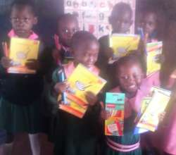 ECD pupils showing off reading books
