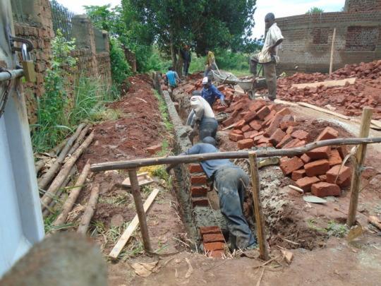 Building the perimeter walls.