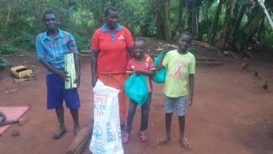 Family receiving emergency supplies.