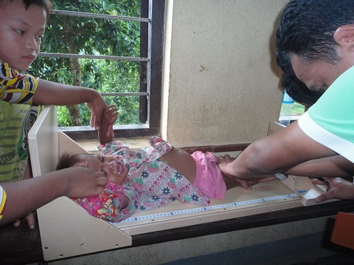 Baby screened for malnutrition at a health clinic