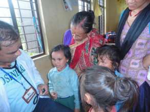Children screened for malnutrition at clinic