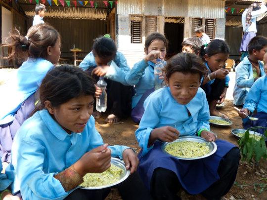 Children taking a break for a healthy lunch