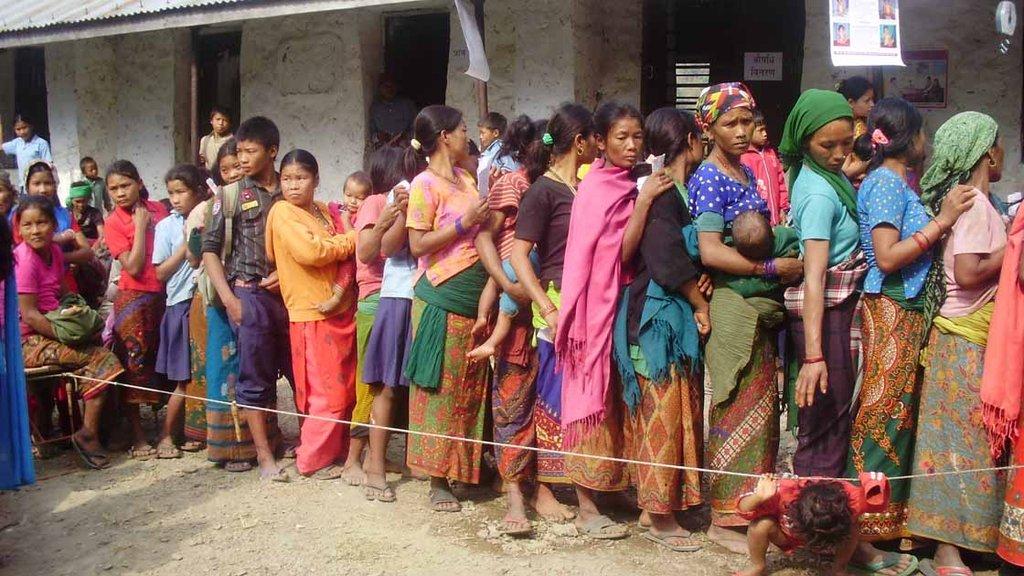 Children lining up for screening